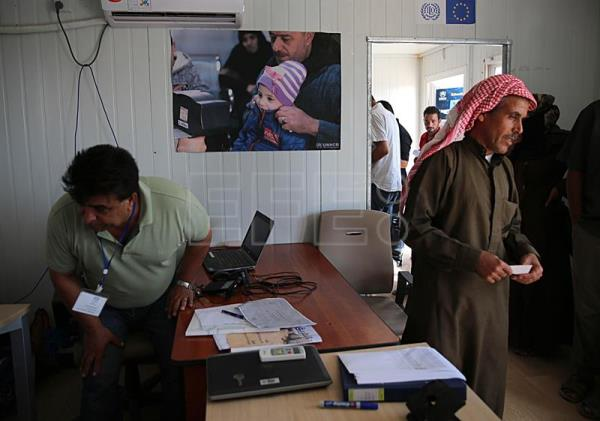 Syrian refugees at the newly opened Zaatari office for employment, at the Zaatari refugee camp, some 80 km East of Amman, Jordan, Sept. 11, 2017. EPA-EFE/AMEL PAIN