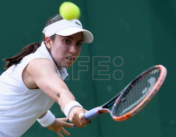 Christina McHale of the USA in action against Agnieszka Radwanska of Poland during their second round match for the Wimbledon Championships at the All England Lawn Tennis Club, in London, Britain, July 6, 2017. EPA/GERRY PENNY EDITORIAL USE ONLY/NO COMMERCIAL SALES