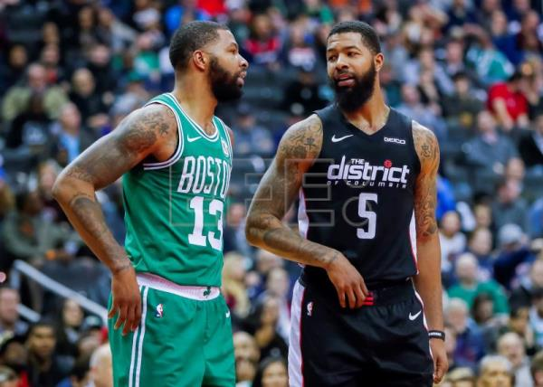 Brothers, Boston Celtics forward Marcus Morris (L) and Washington Wizards forward Markieff Morris (R) speak during the second half of the NBA basketball game between the Boston Celtics and the Washington Wizards at Capital One Arena in Washington, DC, USA, Dec 12 2018. EPA-EFE/ERIK S. LESSER SHUTTERSTOCK OUT