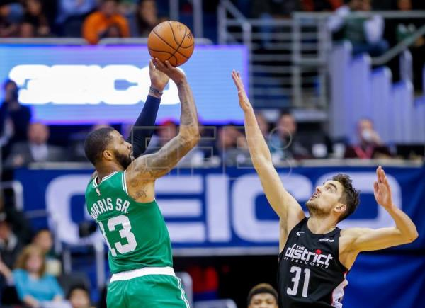 Boston Celtics forward Marcus Morris (L) in action against Washington Wizards guard Tomas Satoransky (R) of the Czech Republic during the second half of the NBA basketball game between the Boston Celtics and the Washington Wizards at Capital One Arena in Washington, DC, USA, Dec 12 2018. EPA-EFE/ERIK S. LESSER SHUTTERSTOCK OUT