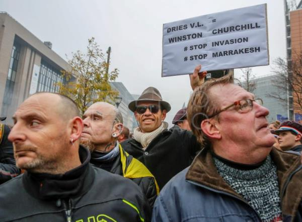 Protesters of right-wing and far-right Flemish associations attend the 'March Against Marrakech' demonstration near European institutions headquarters in Brussels, Belgium, Dec. 16, 2018. EPA-EFE/JULIEN WARNAND