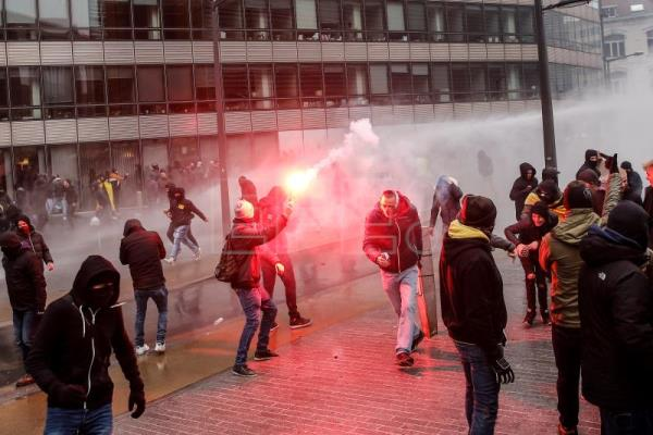 Belgian police use tear gas as disturbances erupt at anti-immigration march