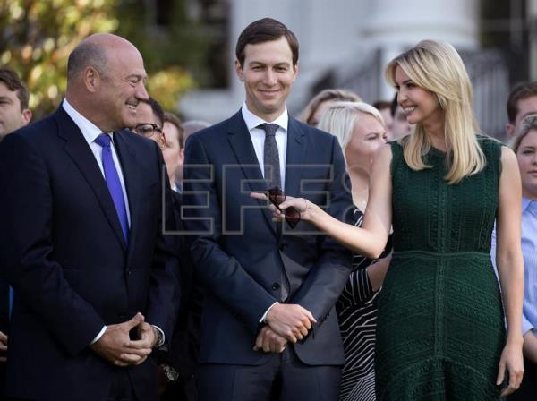 White House economic advisor Gary Cohn (L), senior advisor Jared Kushner (C) and Ivanka Trump (R) talk prior to a moment of silence in remembrance of those lost in the 11 September 2001 terrorist attacks on the South Lawn of the White House in Washington, DC, USA, Sept. 11, 2017. EPA-EFE/SHAWN THEW