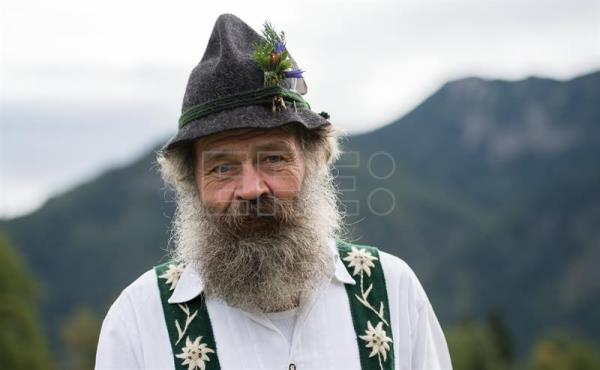 An Allgau herdsman rests during the 'Allgaeu Viehscheid' cattle drive in Bad Hindelang, Germany, Sept. 11, 2017. EPA-EFE/DANIEL KOPATSCH