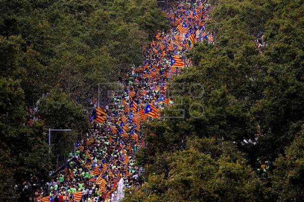 Thousands of people gather in Passeig de Gracia avenue during the National Day of Catalonia (Diada) in Barcelona, Catalonia, Spain, Sept. 11, 2017. EPA-EFE/Toni Albir