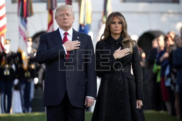US President Donald J. Trump (L) and First Lady Melania Trump (R) lead a moment of silence in remembrance of those lost in the 11 September 2001 terrorist attacks on the South Lawn of the White House in Washington, DC, USA, Sept. 11, 2017. EPA-EFE/SHAWN THEW