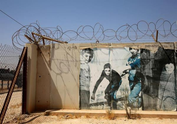 A mural in an office area at the Zaatari refugee camp, some 80 km East of Amman, Jordan, Sept. 11, 2017. EPA-EFE/AMEL PAIN