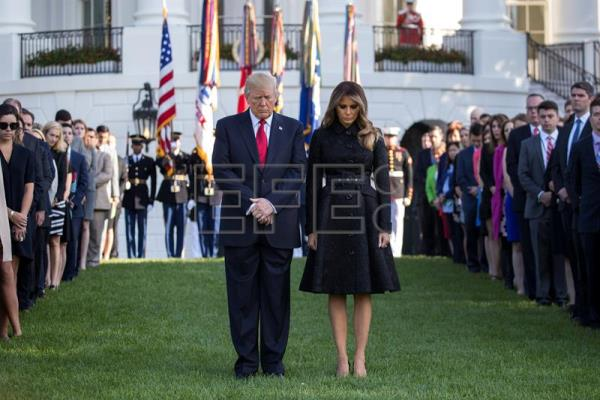 US President Donald J. Trump and First Lady Melania Trump lead a moment of silence in remembrance of those lost in the 11 September 2001 terrorist attacks on the South Lawn of the White House in Washington, DC, USA, Sept. 11, 2017. EPA-EFE/SHAWN THEW