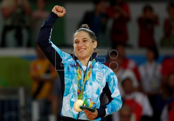 "Paula Pareto of Argentina celebrates her gold medal in women's -48 kgs Judo at the Carioca Arena 2 in the Olympic Park in Rio de Janeiro, Brazil, 06 August 2016. Argentina's Paula Pareto won the gold medal Saturday in the women's 48-kg with a victory over South Korea's Jeong Bo-kyeong in the final, while Kazakh Otgontsetseg Galbadrakh won bronze in that same extra-lightweight category and her countryman, Yeldos Smetov, came away with silver in the men's 60-kg. The 30-year-old Pareto, nicknamed ""Peque,"" also won gold at the 2015 World Judo Championships in Astana, She said afterward that she was very pleased to have defeated a ""tough competitor"" in the final. EPA/ORLANDO BARRIA"