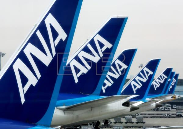 The tails of All Nippon Airways (ANA) passenger planes are visible on the tarmac of Tokyo International Airport at Haneda in Tokyo, Japan, Mar. 31, 2017 (issued 28 Apr. 28, 2017). EPA-EFE FILE/KIMIMASA MAYAMA