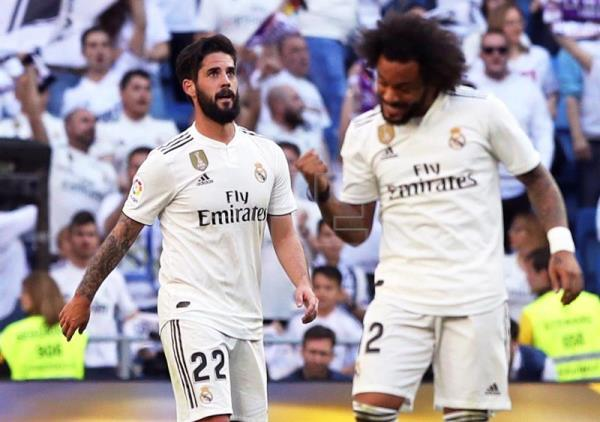 Real Madrid's Isco (L) celebrates with teammate Marcelo (R) after giving his team a 1-0 lead during a Spanish La Liga soccer match against Celta Vigo at Santiago Bernabeu Stadium in Madrid, Spain, on March 16, 2019. EPA-EFE/BALLESTEROS