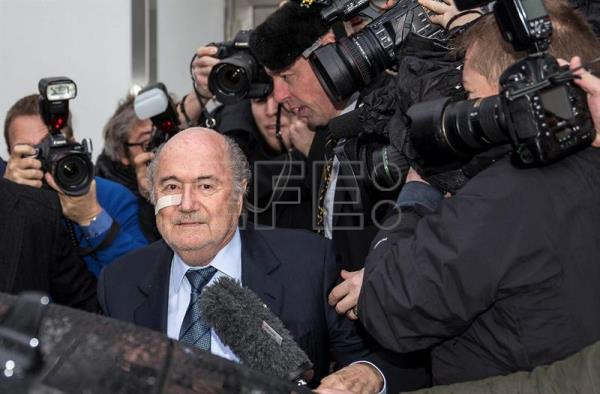 A file Photo dated on Dec. 21, 2015 shows Joseph 'Sepp' Blatter (C) arriving for his press conference to respond to the FIFA ethics committee's verdict, at former FIFA's headquarters Hotel Sonnenberg in Zurich, Switzerland. EPA/PATRICK B. KRAEMER