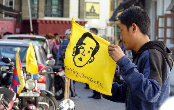 Tibetans in exile ride to New Delhi to fix glare on missing Panchen Lama