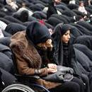 An Iranian woman helps her wheelchair-bound sister pray during a mourning ceremony commemorating the death of Fatima, the daughter of Islam's Prophet Muhammad, in Tehran, Iran, on Mar. 2, 2017. EPA/ABEDIN TAHERKENAREH