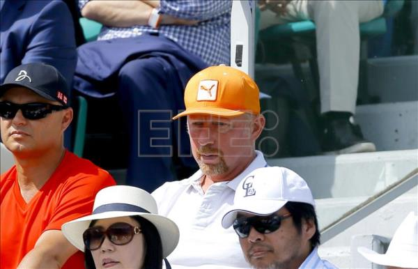 Former tennis player and coach of Serbian Novak Djokovic, German Boris Becker, watches Djokovic playing against Stan Wawrinka of Switzerland during the men's final match for the French Open tennis tournament at Roland Garros in Paris, France, June 7, 2015. EFE/EPA/ROBERT GHEMENT