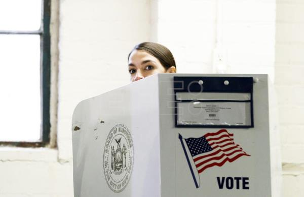 Alexandria Ocasio-Cortez, who is running as the Democratic nominee for New York's 14th congressional district, casts her ballots in the 2018 midterm general election at a polling site in the Bronx, New York, USA, Nov. 6, 2018. EPA-EFE/JUSTIN LANE