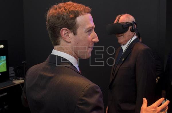 Archive image shows founder and CEO of Facebook Mark Zuckerberg (L) observing Peruvian President Kuczynski (R) trying on a VR headset at the Facebook stand at the Asia Pacific Economic Cooperation Forum (APEC) in Lima, Peru, Nov 16, 2016. EPA/PABLO PORCIUNCULA / POOL  epa05765798 (FILE) - A file picture dated 19 November 2016 shows founder and CEO of Facebook Mark Zuckerberg (L) observing Peruvian President Pedro Pablo Kuczynski (R) who tries a virtual reality headset at the stand of Facebook, during an event in the frame of the Asia Pacific Economic Cooperation Forum (APEC) in Lima, Peru. According to media reports on 02 February 2017, Facebook lost a 500 million US dollar lawsuit to Zenimax, over copyright issues on the computer code used by Oculus VR, which was bought by Facebook in 2014.  EPA/PAB