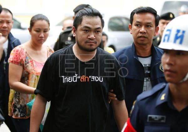 (FILE) Police escort two unidentified Thai citizens (C and 2-L) who alleged violated the Computer Crimes Act into military court in Bangkok, Thailand, 29 April 2016. EPA/NARONG SANGNAK