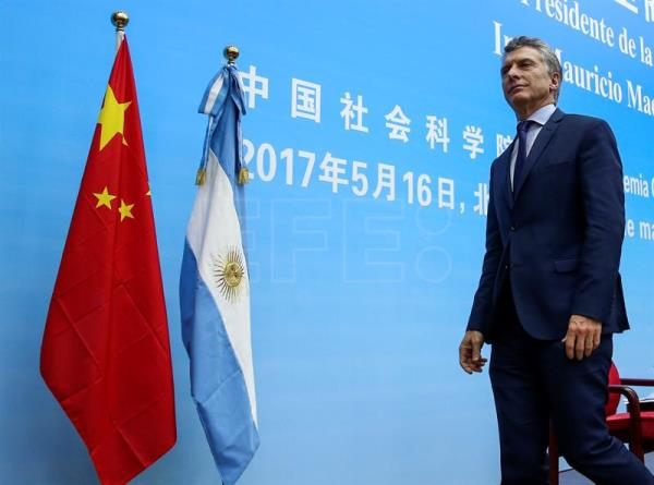 Argentinian President Mauricio Macri leaves after his speech in Chinese Academy of Social Sciences in Beijing, China, 16 May 2017. EPA/ROMAN PILIPEY