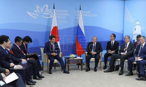Russia and Japan talk stability, G7, amid complex bilateral issues