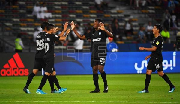 Jonathan Urretaviscaya (2-L) of Pachuca celebrates with his teammates after scoring the 1-0 lead during the FIFA Club World Cup third place soccer match between Al Jazira Club and CF Pachuca in Abu Dhabi, United Arab Emirates. EFE