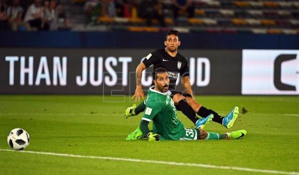 Jonathan Urretaviscaya (back) of Pachuca scores the 1-0 lead against Al Jazira's goalkeeper Khaled Al Senaani (front) during the FIFA Club World Cup third place soccer match between Al Jazira Club and CF Pachuca in Abu Dhabi, United Arab Emirates. EFE