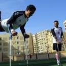 Egyptian amputee Tabet Elgaza (L) does a crutch handstand before the first handicapped soccer match in Cairo, Egypt, Dec. 16, 2017. EPA-EFE/KHALED ELFIQI