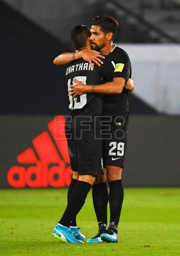 Jonathan Urretaviscaya (L) of Pachuca celebrates with his teammate Franco Jara (R) after scoring the 1-0 lead during the FIFA Club World Cup third place soccer match between Al Jazira Club and CF Pachuca in Abu Dhabi, United Arab Emirates. EFE