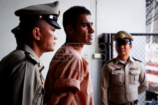 Bahraini soccer player with Australian refugee status Hakeem Al-Araibi (C) walks while escorted by Thai prison officers following an extradition hearing at the Criminal Court in Bangkok, Thailand, Feb. 4, 2019 (reissued Feb. 11, 2019). EPA-EFE FILE/DIEGO AZUBEL
