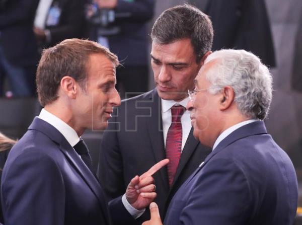 (L-R) France's President Emmanuel Macron, Spain's Prime Minister Pedro Sanchez and Portugal's Prime Minister Antonio Costa talk at the beginning of the North Atlantic Council round table during a NATO summit in Brussels, Belgium, July 11, 2018. EPA/OLIVIER HOSLET