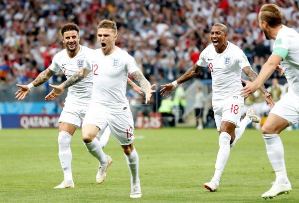 Kieran Trippier of England (2L) celebrates with teammates after scoring the opening goal against Croatia in their World Cup 2018 semifinal match in Moscow on Wednesday, July 11. EFE/EPA/SERGEI CHIRIKOV