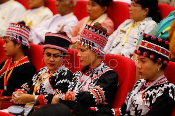 People from Myanmar's ethnic groups attend the third session of the 'Union Peace Conference - 21st century Panglong' in Naypyitaw, Myanmar, Jul. 11, 2018. EPA-EFE/HEIN HTET