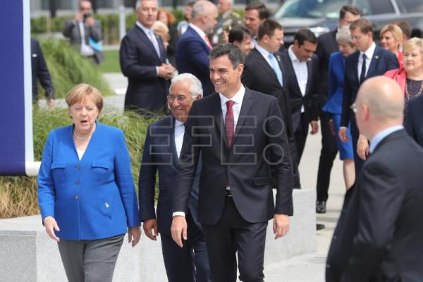 (L-R) German Chancellor Angela Merkel, Portugal's Prime Minister Antonio Costa and Spanish Prime Minister Pedro Sanchez walk together as they arrive for a family picture during a NATO summit in Brussels, Belgium, July 11, 2018. EPA/OLIVIER HOSLET