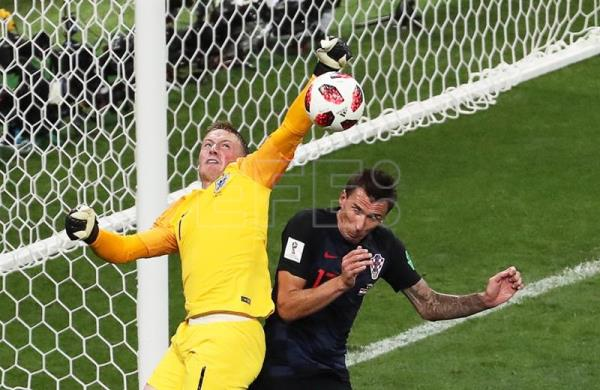 England goalkeeper Jordan Pickford in action against Mario Mandzukic of Croatia during the FIFA World Cup 2018 semifinal in Moscow on Wednesday, July 11 EFE/EPA/ABEDIN TAHERKENAREH