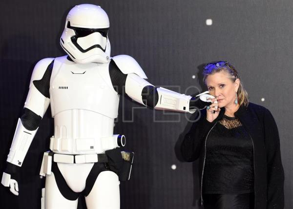 (FILE) A file picture dated 16 December 2015 shows US actress/cast member Carrie Fisher posing next to a storm trooper as she arrives at the European premiere of the film 'Star Wars: The Force Awakens' in Leicester square in London, Britain. EPA/FACUNDO ARRIZABALAGA