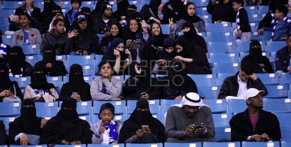 Saudi families attend Saudi league soccer match between Al Hilal and Al Ittihad at King Fahd Stadium in Riyadh, Saudi Arabia. EFE