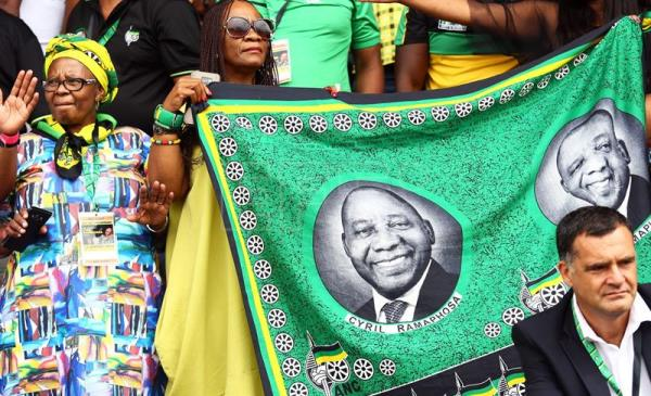 Supporters hold aloft material depicting newly elected ANC (African National Congress) President, Cyril Ramaphosa during the ANC 106th anniversary celebrations at ABSA Stadium, East London, South Africa, 13 January 2018. EFE
