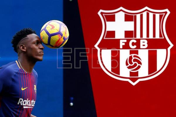 Yerry Mina poses during his presentation as new Barcelona player at the Camp Nou stadium in Barcelona, Spain, Jan. 13, 2018. EPA-EFE/Alberto Estevez