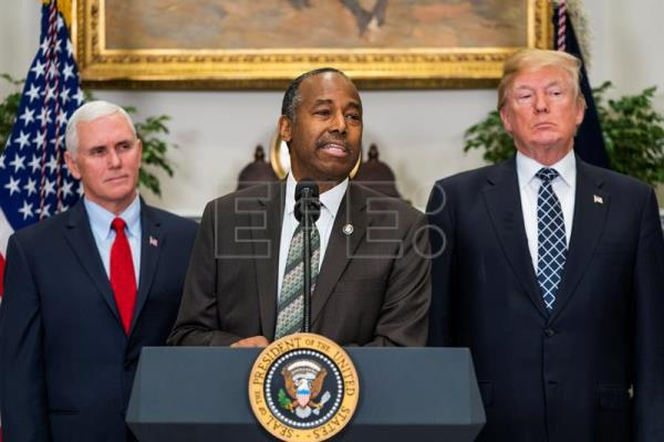 Secretary of Housing and Urban Development Ben Carson (C), alongside US President Donald J. Trump (R), and Vice President Mike Pence (L), speaks before President Trump signed a proclamation to honor Dr. Martin Luther King, Jr. Day in the Roosevelt Room of the White House in Washington, DC, USA Jan. 12, 2018. EPA-EFE/JIM LO SCALZO