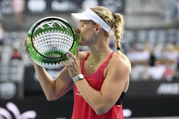 Angelique Kerber poses for a photograph with the winner's trophy at Sydney Olympic Park Tennis Centre in Sydney, Australia, Jan. 13, 2018. EPA-EFE/DAN HIMBRECHTS