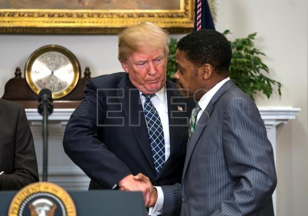 US President Donald J. Trump (L) shakes hands with President for the Martin Luther King, Jr. Center Isaac Newton Farris, Jr.(R), before President Trump signed a proclamation to honor Dr. Martin Luther King, Jr. Day in the Roosevelt Room of the White House in Washington, DC, USA Jan. 12, 2018. EPA-EFE/JIM LO SCALZO