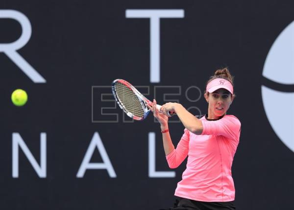 Mihaela Buzarnescu in action against Elise Mertens during their finals match of the Hobart International tennis tournament at Domain Tennis Centre in Hobart, Tasmania, Australia, Jan. 13, 2018. EPA-EFE/ROB BLAKERS