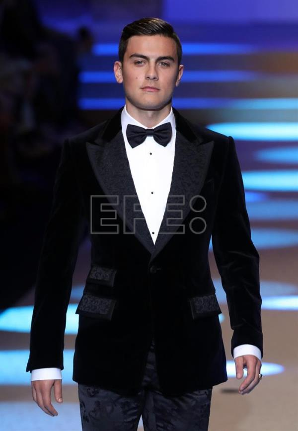 FC Juventus forward Paulo Dybala presents a creation of Italian fashion label Dolce&Gabbana during the Milan Fashion Week, in Milan, Italy, 13 January 2018. EFE