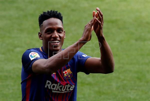 Yerry Mina reacts during his presentation as new Barcelona FC player at the Camp Nou stadium in Barcelona, Spain, Jan. 13, 2018. EPA-EFE/Alberto Estevez