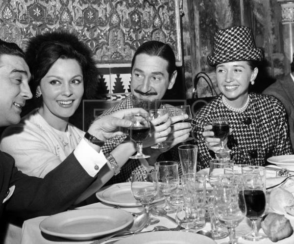 (L-R) Spanish Guitar player Antonio Gonzalez, aka 'El Pescailla', actress Paquita Rico, actor Jaime de Mora and the Countess of Romanones toast for the Silver Chickpea (Garbanzo de Plata) prize awarded to flamenco artist Lola Flores, Feb 12, 1964. EPA- EFE (FILE)/fs