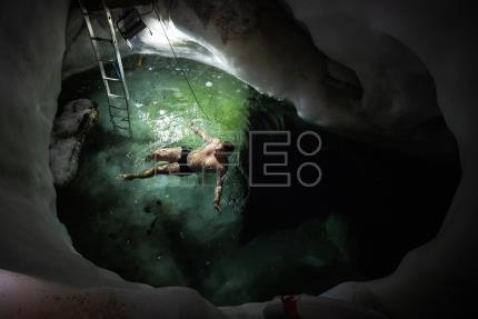 Ice swimmers brave freezing temperatures in glacial cave system in Austria