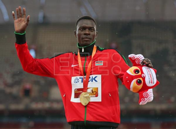 Nicholas Bett of Kenya celebrates on the podium after winning the gold medal in the men's 400m Hurdles final during the Beijing 2015 IAAF World Championships at the National Stadium, also known as Bird's Nest, in Beijing, China, Aug. 26, 2015. EPA-EFE FILE/WU HONG