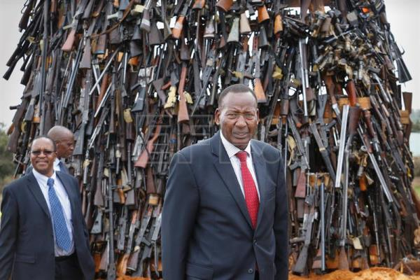 Kenya's Interior Cabinet Secretary Joseph Nkaissery inspects piles of illegal firearms before they were set alight at a field in Ngong, in the outskirts of the capital Nairobi, Kenya, 15 November 2016. EPA/DAI KUROKAWA