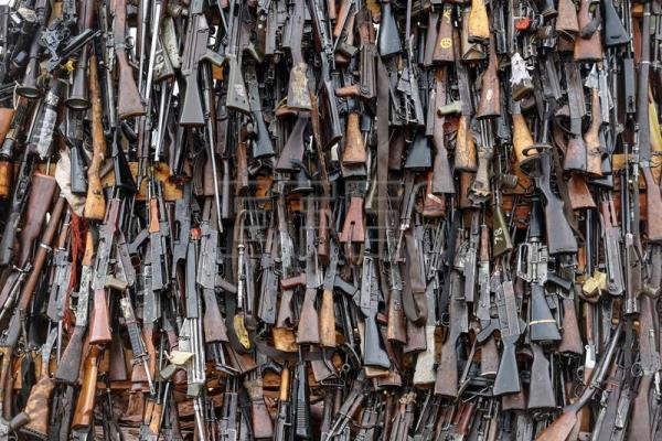 Assault rifles and other firearms are seen in a pile of illegal firearms before it was set alight at a field in Ngong, in the outskirts of the capital Nairobi, Kenya, 15 November 2016. EPA/DAI KUROKAWA