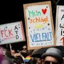 People hold placards during protest against a demonstration of the 'Alternative for Germany' (AfD) party in Berlin, Germany, May 27, 2018. EPA/HAYOUNG JEON